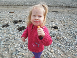 Kaylah was excited to be at the beach! She is holding up what was left of her ice cream cone.