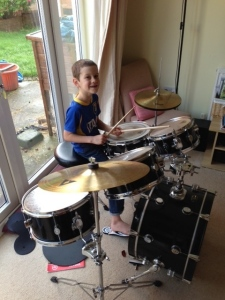 One of Joel's birthday highlights was getting a drum set. Several relatives went together to get it for him. He's having lessons now and our house is (not!) quiet. :-)