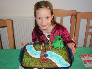 Sweet Mariah with her Robin Hood cake. (yes she ended up with two cakes this year . . .the heart one on her real birthday!)