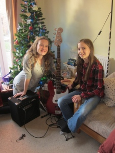 Several relatives went together and bought Hannah and Aliyah a bass guitar.  They are excited to learn to play it!