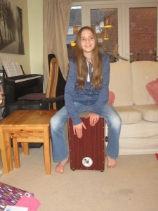 She was thrilled to receive a box drum as a gift from several relatives. She's already played once for church!