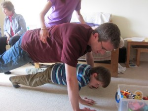 The Mead men doing press-ups! Watch out, Mariah is about to climb on top!