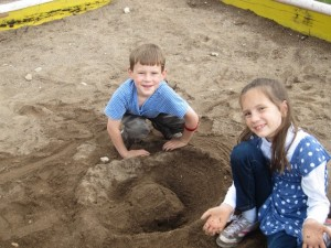 "The military theme continued . . . Joel and Mariah made a ""military camp"" in the sandpit."