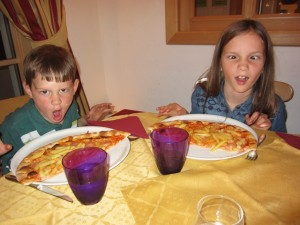"""I have never seen so many types of pizza on a menu before.  Mariah and Joel split a """"dragonball"""" pizza which had ham and french fries on it!  Here are their best dragon faces!"""