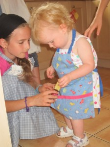 """Aliyah let Kaylah """"help"""" in the project by loading her apron with apple cores . . ."""