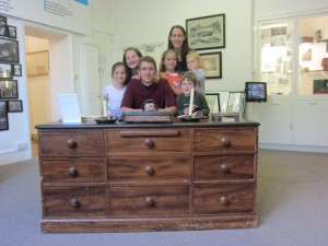 Recently, I read a book at George Muller to the kids and we watched a dvd about him.  So we had fun visiting a little museum about him.  Here we all are behind Muller's desk.