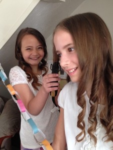 Next we did each other's hair! Here Alex (my friend) is curling my hair.