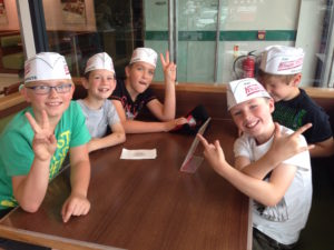 Here's Joel and some of his friends from church at Krispy Kreme - kids' club outing.