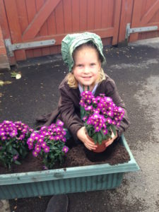 Miss Kaylah helping me plant some September asters in memory of the little unborn one we lost two years ago.